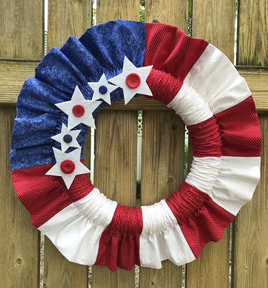 Decorate for the 4th of July with a cute ruffled ed white and blue stars and stripes wreath