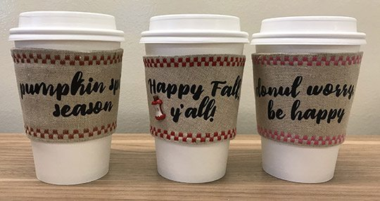 Autumn-themed coffee cup cozies